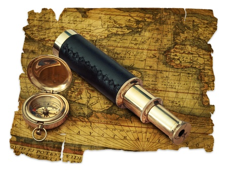 traveling theme: vintage telescope and compass at antique (17 century) map over white