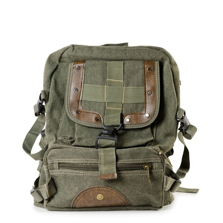 Old tarpaulin backpack over the white background