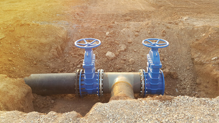 Photo pour Blue butterfly valve on floor and PE. black pipe for raw water pump - image libre de droit