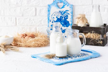 Photo pour Bottles of milk of various shapes and sizes on a light background - image libre de droit