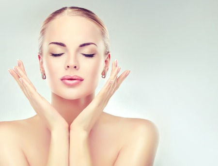 Photo pour Beautiful  Woman with Clean Fresh Skin close up . Skin care face . Cosmetology and makeup - image libre de droit