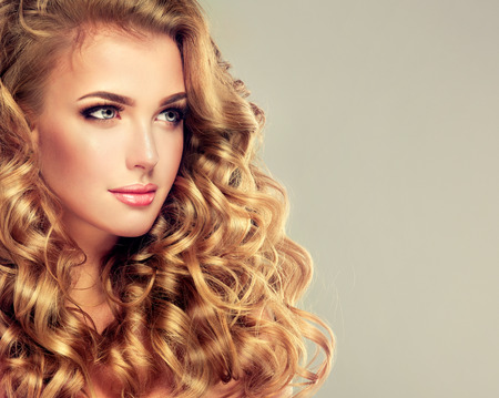 Photo pour Blondel girl with long wavy hair .  Beautiful  model with curly hairstyle. - image libre de droit