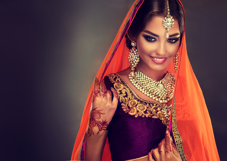 Photo for Young hindu woman model with tatoo mehndi and kundan jewelry . Traditional Indian costume lehenga choli . - Royalty Free Image