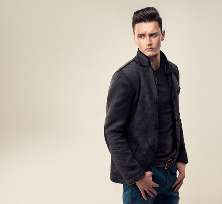 Photo for Portrait of a handsome young man with trendy hairstyle, dressed in a stylish and fashionable wool jacket. - Royalty Free Image