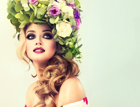 Lady Spring. Beautiful woman model with flower wreath on his head and makeup-smoky eyes style.の素材 [FY31072097175]