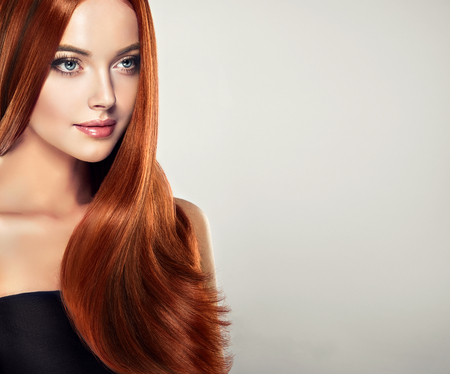 Photo pour Young, brown haired, woman  with straight and voluminous hair.Exllent wave of hair. - image libre de droit
