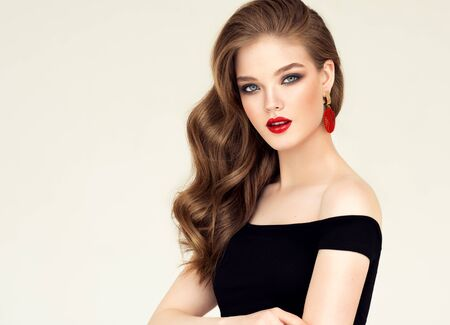 Photo pour Portrait of perfectly looking young brown haired woman dressed n splendid evening makeup.Makeup, cosmetic and manicure. - image libre de droit