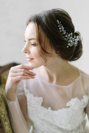 Photo for Beauty portrait of a bride with exquisite decoration in her hair, studio indoor photo. - Royalty Free Image