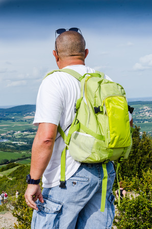 an hiker at the mountain, color and vertical composition