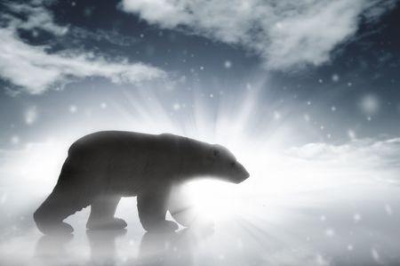 A silhouetteed polar bear walking in a snow storm.