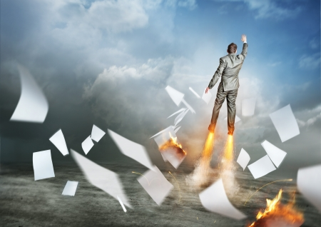 Businessman Success  A businessman launching upwards, paperwork flying everywhere