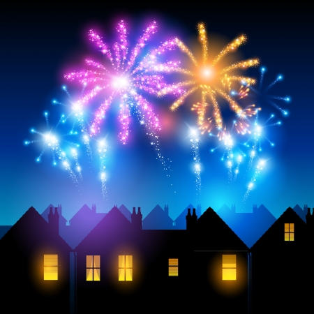 Fireworks lighting up the sky behind town houses