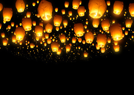 A large collection of flying chinese lanterns.