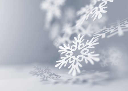 Falling Snowflakes. Paper craft snowflakes close up illustration of falling snowflakes. Christmas winter background.