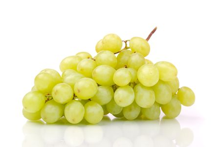One whole cluster of green grapes on white