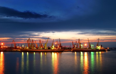 Photo for Port warehouse with cargoes and containers at night - Royalty Free Image