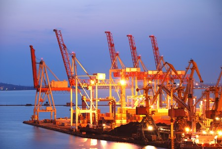 Photo pour Port warehouse with cargoes and containers at night - image libre de droit