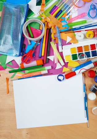 artwork workplace with creative accessories, art tools for painting and drawing