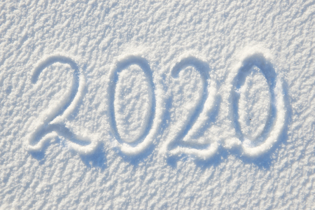 Photo pour 2020 text written on snow for texture or background - winter holiday concept Sunny day, bright light with shadows, flat lay, top view, clean and nobody - image libre de droit