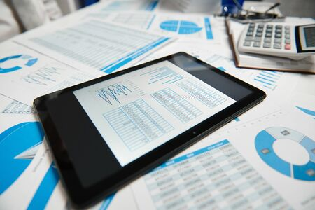 Photo pour Office workspace for business. Tablet pc and reports. Table closeup. Business financial accounting concept. - image libre de droit