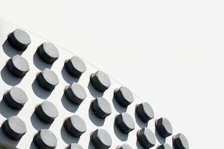 Photo pour large head bolts on white metal construction as background - engineering concept - image libre de droit
