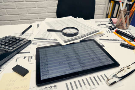 Photo for Business analysis and accounting concept - Office desk closeup with document, spreadsheet, calculator, tablet pc. - Royalty Free Image