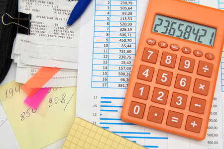 Photo pour business office desk closeup - financial reports, analysis and accounting, set of documents, tables and graphs, various items for bookkeeping, calculator - image libre de droit