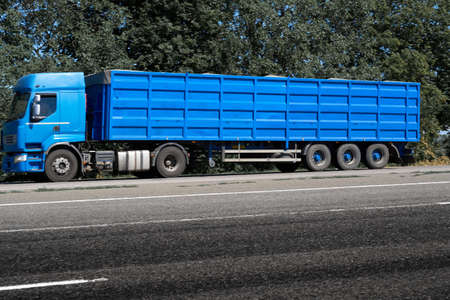 Photo for truck on the road, side view, empty space on a blue container - concept of cargo transportation, trucking industry - Royalty Free Image