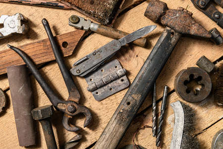 Photo for Old vintage household hand tools still life on a wooden background in a DIY and repair concept - Royalty Free Image