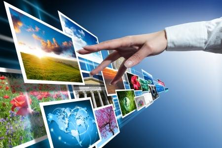 Photo pour multimedia touch with hand - image libre de droit