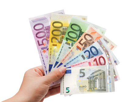 euro banknotes in hand on white  65532;