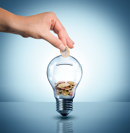 Photo for invest to energy concept - euro in bulb - piggybank  - Royalty Free Image