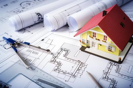 Foto de house on blueprints  housing project - Imagen libre de derechos