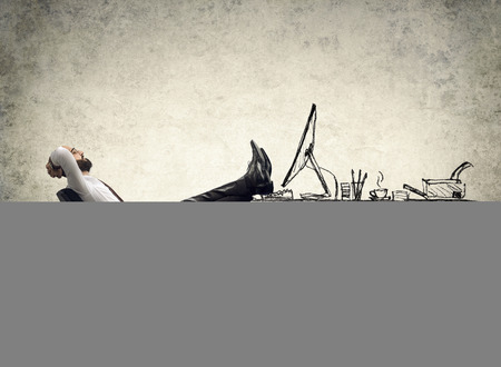 Photo pour relax in office  man sitting on the drawing of desk - image libre de droit