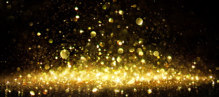 Photo pour Shimmer Of Golden Glitter On Black - image libre de droit