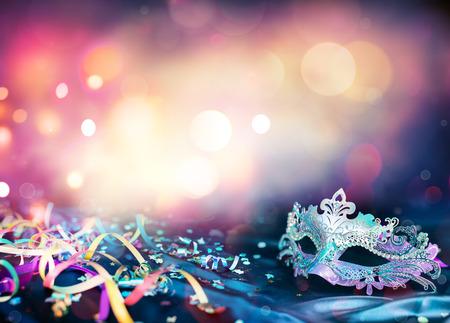 Foto de Carnival Mask, Streamers And Confetti For Festive Background - Imagen libre de derechos