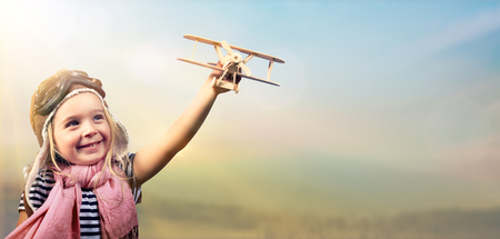 Photo for Freedom To Dream - Joyful Child Playing With Airplane Against The Sky - Royalty Free Image