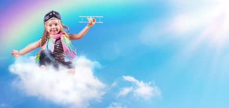 Photo for Full-Color Adventure - Child Flying On The Cloud With Airplane And Rainbow - Royalty Free Image
