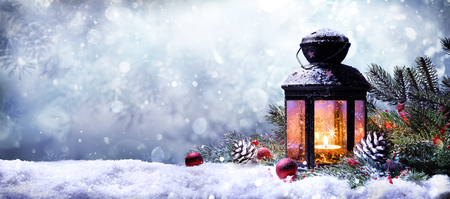 Foto de Lantern With Fir Branches On Snow - Imagen libre de derechos