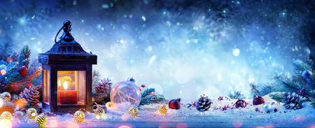 Foto de Snowy Lantern With Fir Branches And Baubles - Christmas Card - Imagen libre de derechos