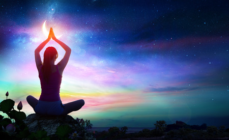 Photo for Woman Doing Yoga With Lotus Flowers And Chakra Gradient Colors - Spiritual Contemplation - Royalty Free Image