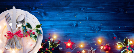 Photo for Vintage Silverware On Blue Tab For Christmas Dinner - Royalty Free Image