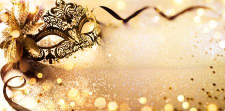 Photo pour Venetian Golden Mask On Shiny Defocused Background - image libre de droit