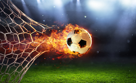 Photo for Fiery Soccer Ball In Goal With Net In Flames - Royalty Free Image