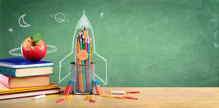 Photo pour Back To School - Books And Pencils With Rocket Sketch - image libre de droit