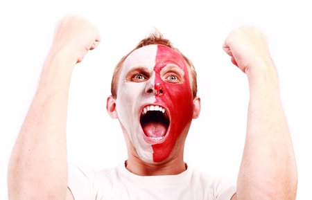 Screaming football fan with face  painted in Poland color