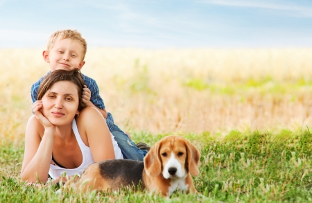 Photo for Calm family leisure scene on the green meadow - Royalty Free Image