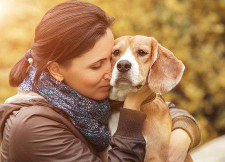 Photo pour Woman and her favorite dog portrait - image libre de droit