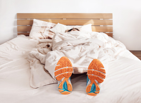 Foto de All time ready to run. Runner sleep in comfort run shoes - Imagen libre de derechos