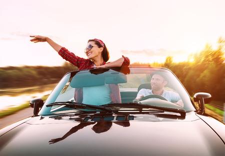 Foto de Couple in love traveling by cabriolet - Imagen libre de derechos